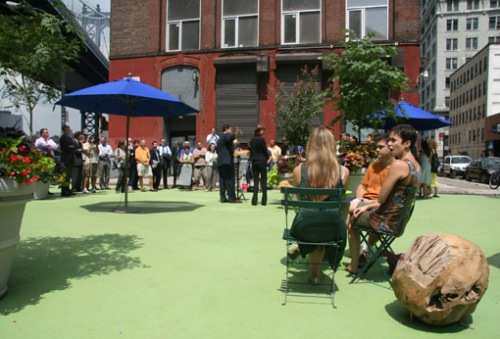 Image from Streetblog of Pearl Street Plaza, a triangular pocket park that only a few weeks ago served as a parking lot and illegal dump.